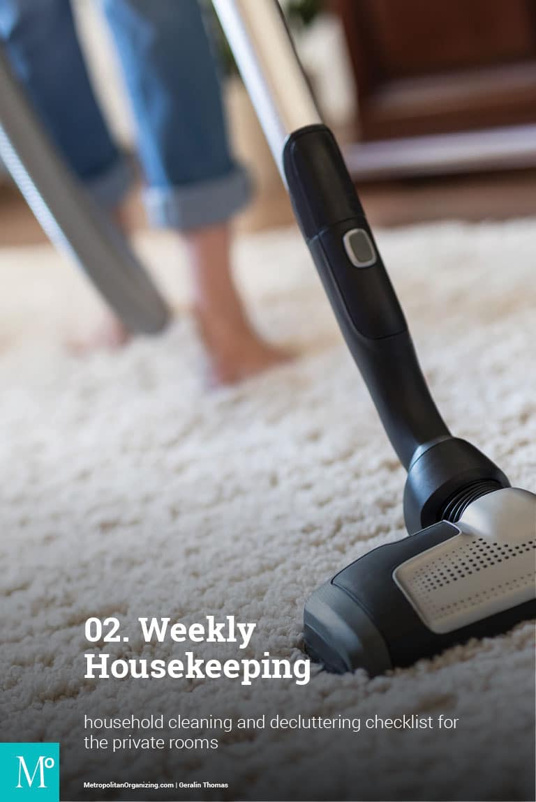 vacuum cleaning  a white carpet barefoot and in blue jeans