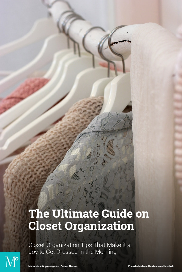 pink gray tan clothes on white hangers