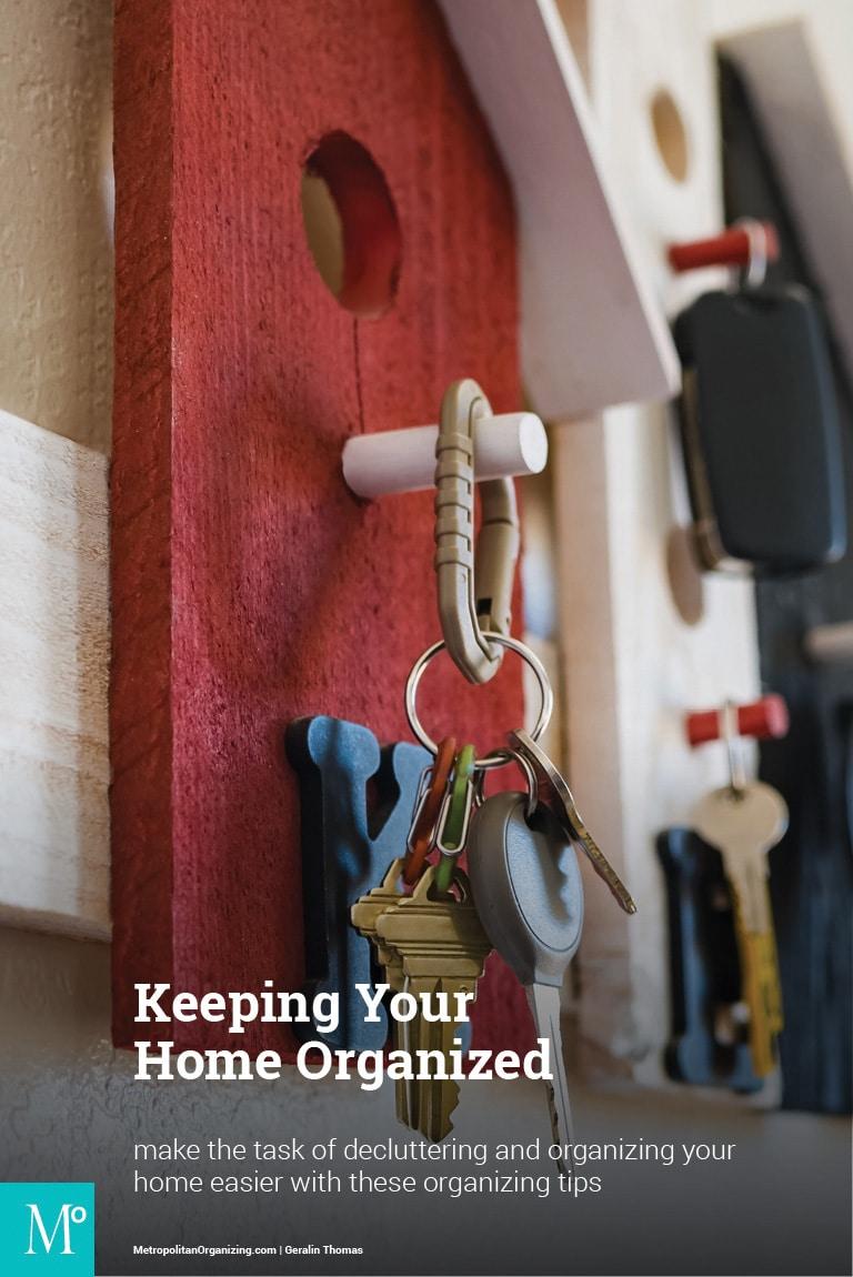 Keys on a keychaing hangin on a wall