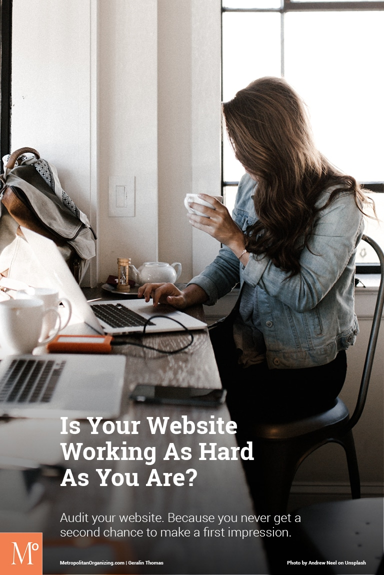young woman on a laptop drinking a cup of coffee